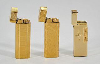 Group of Three Vintage Cartier and Penguin Lighters