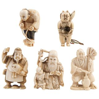 """SET OF NETSUKES JAPAN, EARLY 20TH CENTURY Carved in ivory with ink details Some signed 1.9"""" (5 cm)"""