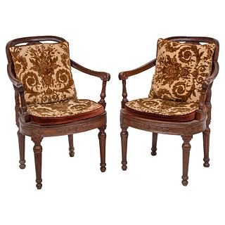 """PAIR OF ARMCHAIRS 20TH CENTURY Carved wood with bejuco on backs and seats, upholstered cushions with floral motifs 33.8 x 19.6 x 21.6"""" (86 x 50 x 55 c"""