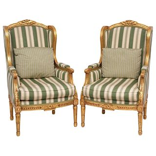 """PAIR OF BERGERE ARMCHAIRS 20TH CENTURY Carved and gilded wood, closed backs and linear upholstery 42.1 x 24.4 x 20.8"""" (107 x 62 x 53 cm)"""