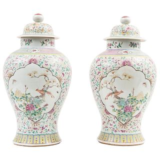 """PAIR OF JARS Oriental Origin, Early 20th century Made of porcelain with floral, bird and organic motifs 17.7"""" (45 cm) tall"""