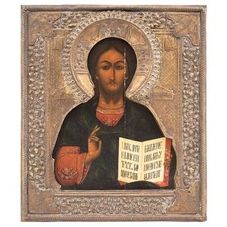 """ICON RUSSIA, 19TH CENTURY CHRIST PANTOCRATOR Oil on wood, with gold and silver metallic foil jacket 12.4 x 10.8"""" (31.5 x 27.5 cm)"""