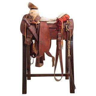 "FAENA SADDLE MEXICO, 20TH CENTURY Smooth square skeleton saddle with ""Silao"" style shaft"