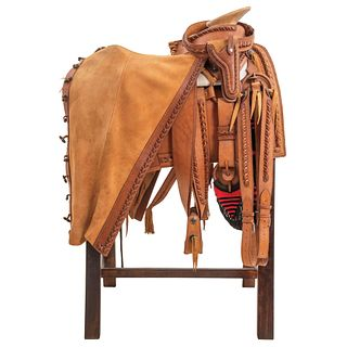 FAENA SADDLE MEXICO, 20TH CENTURY Complete set of smooth leather with braid trimmings