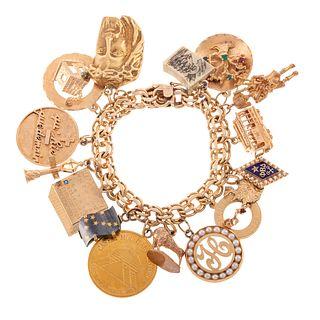 A Heavy 14K Vintage Bracelet Featuring 16 Charms