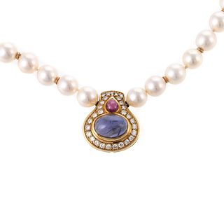 A Pearl Necklace with Ruby & Iolite Pendant