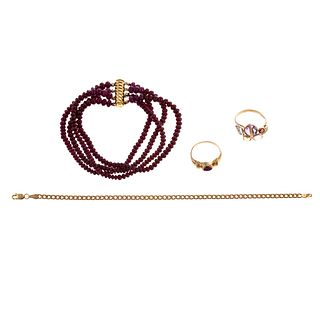 A Collection of Gemstone Rings & Bracelets in Gold