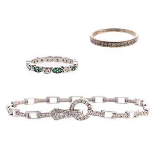 A Diamond Link Bracelet & Diamond Bands in Gold