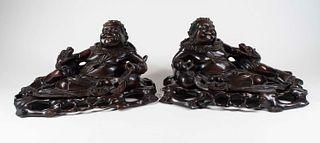 Pair Carved Hardwood Reclining Buddha Figures