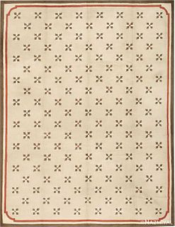 EARLY AMERICAN TUFTED RUG. 15 ft 4 in x 11 ft 10 in (4.67 m x 3.61 m).