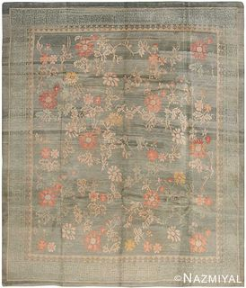 VINTAGE NEPALESE FLORAL RUG. 9 ft 3 in x 7 ft 10 in (2.82 m x 2.39 m).