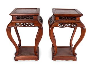 A Pair of Chinese Pierce-Carved Rosewood Stands Height 18 x width 12 1/2  x depth 12 1/2 inches.