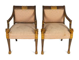 A Pair of Egyptian Revival Parcel-Gilt Mahogany Armchairs Height 33 1/2 x width 24 x depth 18 1/2 inches.