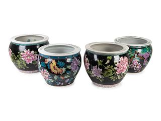 Two Pair of Chinese Famille Noire Porcelain Jardinieres Height 9 1/2 and 8 inches; diameters 12 and 11 inches.