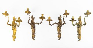 A Set of Four Louis XV Style Gilt-Bronze Sconces Height 14 x width 10 x depth 7 1/2 inches.
