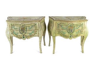 A Pair of Italian Rococo Style Painted Commodes Height 34 1/2 x length 36 x depth 19 inches.