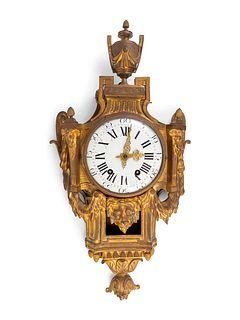A Louis XVI Style Gilt-Bronze Cartel Clock Height 32 x width 17 1/2 x depth 3 3/4 inches.