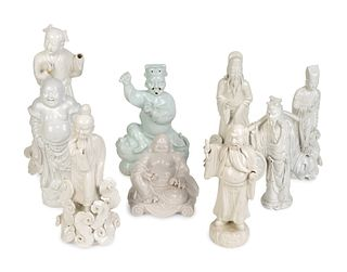 Nine Chinese Blanc de Chine Porcelain Figures of Buddha, Confucius, Sages and Dignitaries Heights 5 2/4 to 13 ½ inches.