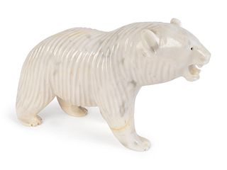 A Carved and Polished White Marble Figure of a Polar Bear Height 8 1/4 x length 14 x width 4 inches.