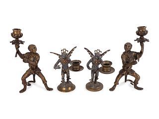 Two Pair of Bronze Monkey-Form Candlesticks Heights 8 1/2 and 5 1/2 inches.