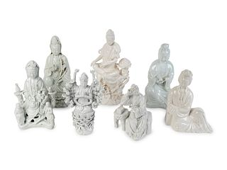 Seven Chinese Blanc de Chine Porcelain Figures of Seated Guanyin and Maidens Heights 7 to 11 ¾ inches.