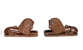 A Set of Four English Brown-Glazed Stoneware Recumbent Lions Height 17 x length 31 x width 12 inches.