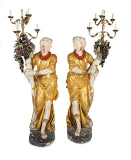 A Pair of Italian Baroque Style Parcel-Gilt and Carved Wood and Gesso Figural Candelabra Height 74 inches.