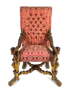 An Italian Baroque Style Carved Walnut Figural Armchair Height 62 x width 36 x depth 30 inches.