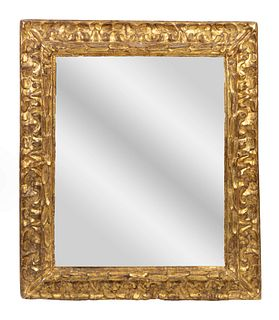 An Italian Baroque Giltwood Mirror Height 44 x width 38 inches.