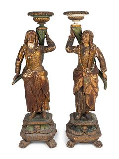 A Pair of Italian Baroque Parcel-Gilt and Polychromed Figures Height 58 1/2 x width 20 x depth 14 inches.