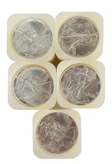 Five Rolls of Liberty Silver Eagles, one hundred 1987 coins total.