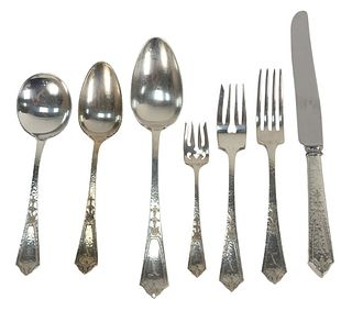 Seventy Two Piece Sterling Silver Flatware Set, hand hammered, along with a large salad set, 111 t.oz., plus 11 handles.