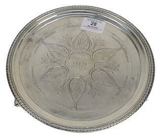 J.E. Caldwell Coin Silver Salver on three feet, diameter 9 inches, 12.9 t.oz. Provenance: From a Newport, Rhode Island historic home, in the same fami