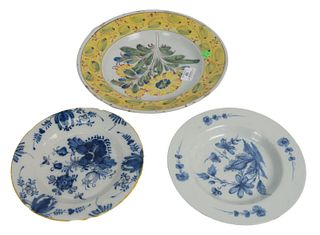 Three Delft Pieces to include a deep charger with 4 colors, along with two blue and white plates, diameters 9 1/4, 12, and 19 1/4 inches. Provenance: