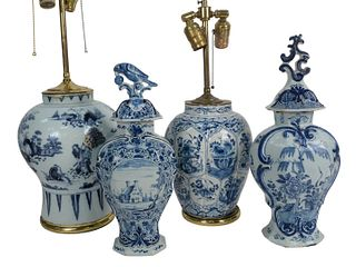 Group of Four Blue and White Delft Pieces to include a vase with foliate panel design, a vase with Oriental garden landscape with figures, repaired, 1
