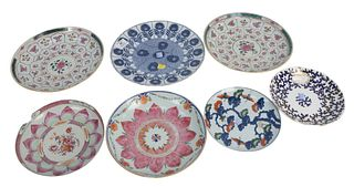 Seven Porcelain Plates to include Chinese Famille Rose saucer plates, a pair decorated with lotus form cartouches with flowers, two with large pink lo