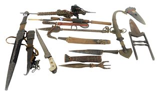 Group of Knives and Daggers to include a Japanese dagger with bone sheath and handle, Middle Eastern daggers, a folding dagger, an Indian knife, etc.,