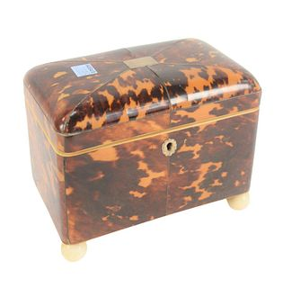 Regency Tortoiseshell Tea Caddy, having silver inlay, lift top opening to two fitted compartments with covers, height 5 1/2 inches, length 7 inches.