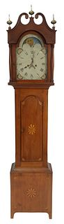 Federal Cherry Tall Case Clock, having tombstone painted dial and moon phase cage, broken arch top with three brass finials over door over base with b