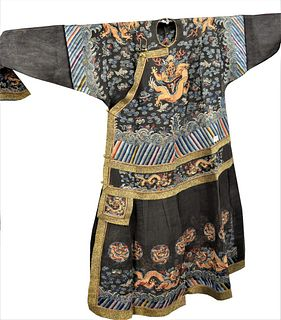 Three Chinese Robes, to include a five claw dragon robe having silk and gold threads, dragon amongst clouds and cranes; purple foo lion robe; along wi