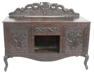 "Chinese Hardwood Sideboard, with carved dragons, probably 19th century, cabinet height 35 inches, total height 46 1/4 inches, top 25"" x 58 1/2""."