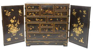 Chinese Chinoiserie Cabinet black lacquered having two doors opening to fitted interior with drawers and doors, all painted with landscape and scrolli