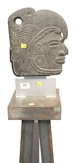 Carved Stone Bust of A Deity wearing a headdress in Egyptian taste mounted on pedestal stand, face height 10 1/2 inches, total height 59 inches.
