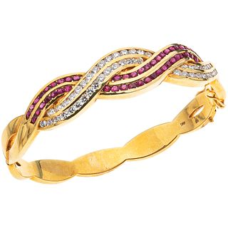 BRACELET WITH RUBIES AND DIAMONDS IN 18K YELLOW GOLD with 48 round cut rubies ~1.44 ct and 47 brilliant cut diamonds ~2.0 ct
