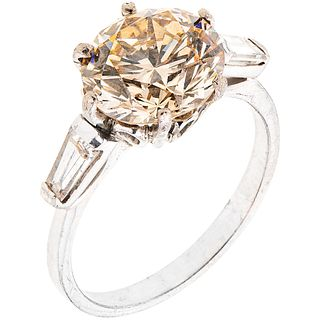 RING WITH DIAMONDS IN PALLADIUM SILVER 1 brilliant cut diamond ~3.23 ct Clarity: VS2 and 2 Baguette cut diamonds. Size: 6 ¾