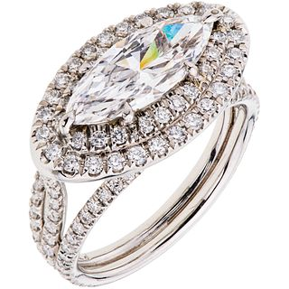 RING WITH DIAMONDS IN PLATINUM 1 marquise cut diamond ~1.67 ct Clarity: VS2 and 132 brilliant cut diamonds ~1.0 ct. Size: 6