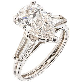RING WITH DIAMONDS IN PLATINUM 1 pear cut diamond ~2.40 ct Clarity: VS2 and 4 baguette cut diamonds ~0.80 ct. Size: 6
