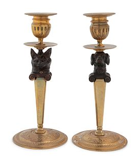 A Pair of Continental Gilt and Patinated Bronze Figural Candlesticks