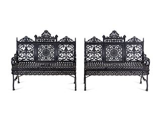 A Pair of American Gothic Revival Painted Cast Iron Garden Benches