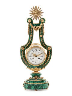 A Louis XIV Style Gilt Metal Mounted Malachite Veneered Harp Clock